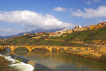 Medieval stone bridge over river, Rio Ebro, in Spring, San Vicente de la Sonsierra, La Rioja, Spain