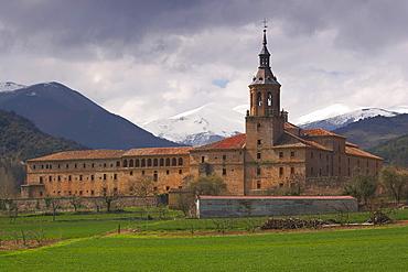 Snow topped mountain range, Sierra de la Demanda, behind a monastery, Monasterio de Yuso, San Millan de la Cogolla, La Rioja, Spain