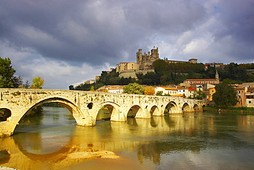 Roman bridge over the river Orb and view of town and cathedral, Beziers, Department Herault, France