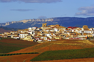 Landscape along the Camino de Santiago with mountains and village, Sierra de Santiago de Loquiz, Cirauqui, Navarra, Spain