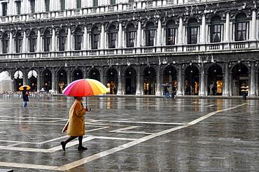 Rainy Piazza San Marco, Venice, Veneto, Italy, woman with umbrella