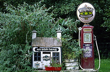 Europe, Great Britain, Ireland, Co. Kerry, old gas station with Murphy's beer sign on top near a pub in Lauragh on the Ring of Beara