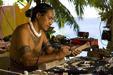 Bone carver at work, Ua Pou, Marquesas, Polynesia, Oceania