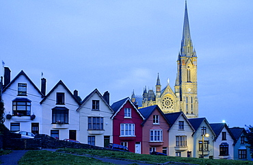 Europe, Great Britain, Ireland, Co. Cork, painted houses in the town centre of Cobh (West View), in the background St. Coleman's cathedral