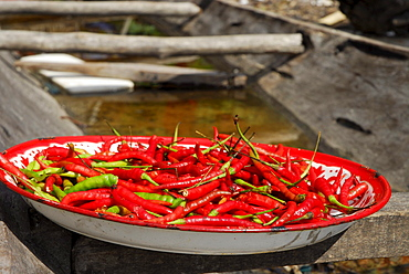 Hot as hell, Chilli peppers, Chillis drying in a pan, Chao Nam village, Surin Islands Marine National Park, Ko Surin, Phang Nga, Thailand
