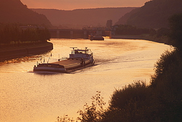 Freighter on the Rhine-Main-Danube Canal at sunset, Lower Bavaria, Germany