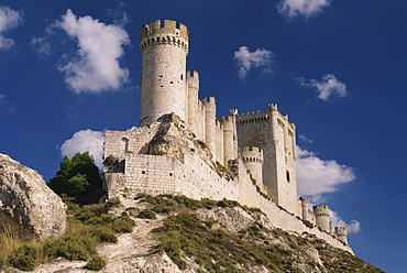 Castillo de Penafiel castle on the hilltop of a rocky ridge against the blue sky, Valladolid province, Castilla-Leon, Northern Spain