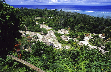 View at a boy and a village on Tikopia, Solomon Islands, Oceania