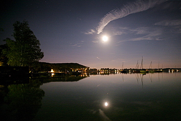 Refelction of the moon and sailing boats in the lake, Steinebach, Lake Woerthsee, Ipper Bavaria, Bavaria, Germany