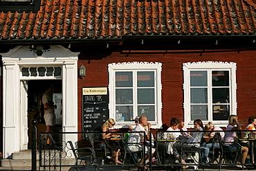 People sitting outside a street cafe, Kaffestugan, Visby, Gotland, Sweden