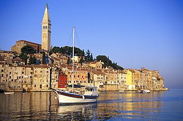 Sailing boat passing Old Town, Sv. Eufemija church, Rovinj, Istria, Croatia