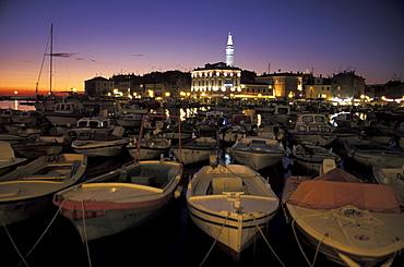 Boats in harbor, cityscape at night, Rovinj, Istria, Croatia