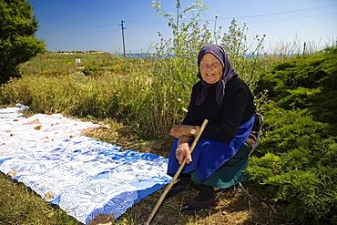 Peasant woman selling handicraft, Cape Kaliakra, Bulgaria