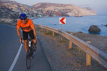 Man bicycling at Petra tou Romiou, Aphrodites birthplace, Petra tou Romiou, Cyprus