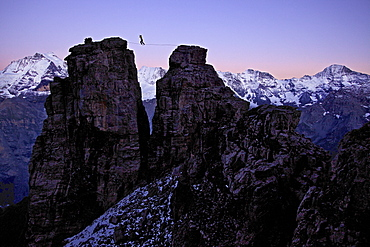 Man walking a highline between two rocks, Schilthorn, Bernese Oberland, Canton of Bern, Switzerland