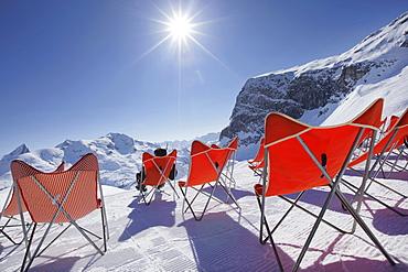 Deck chairs in the snow, Zurs, Arlberggebiet, Austria