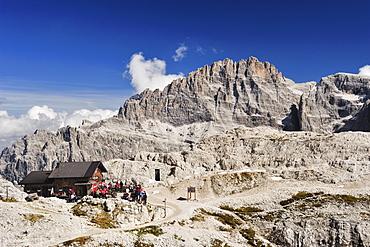 Alpine hut Rifugio Pian di Cengia with Elferkofel, Tre Cime di Lavaredo range, Sexten Dolomites, Dolomites, UNESCO World Heritage Site, South Tyrol, Italy