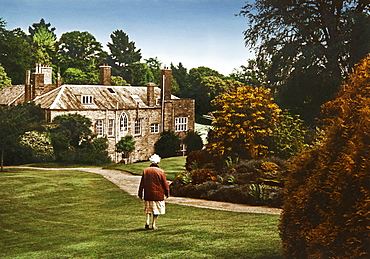 Old woman in front of manor house Prideaux Place, Padstow, Cornwall, Southern England, Great Britain, Europe