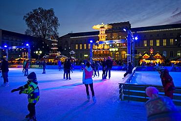 People ice skating at the Christmas market, Karlsruhe, Baden-Wuerttemberg, Germany