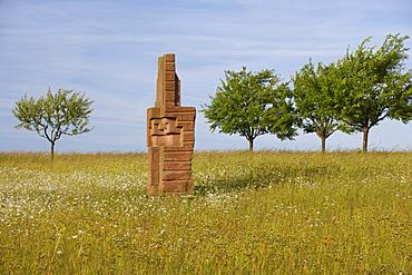 Agricultural landscape with sculpture, Skulpturenstrasse, Steine an der Grenze, Near Scheuerwald, Saarland, Germany, Europe