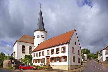 Round tower of St. Mark's church under clouded sky, Reinheim, Bliesgau, Saarland, Germany, Europe