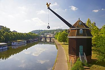 View of crane Saarkran and Old Bridge at the river Saar in the sunlight, Saarbruecken, Saarland, Germany, Europe