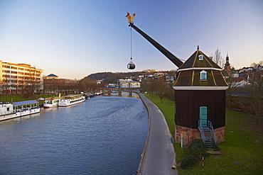 View of crane Saarkran and Old Bridge at the river Saar in the evening, Saarbruecken, Saarland, Germany, Europe