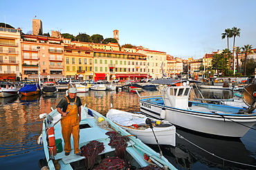Fisherman at the old harbour, Cannes, Cote d'Azur, South France, Europe