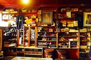 Chock-full racks at a wall at Dick Mack's Pub, Dingle, County Kerry, Ireland, Europe