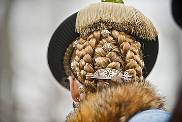 Woman with plaited hair, Leonhardi procession, Bad Toelz, Upper Bavaria, Bavaria, Germany