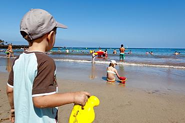 Boy on the beach, Playa de Cucharas, Costa Teguise, Lanzarote, Canary Islands, Spain, Europe