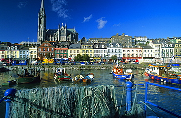 View over the harbour at the houses of the Old Town with St. Colman´s cathedral, Cobh, County Cork, Ireland, Europe
