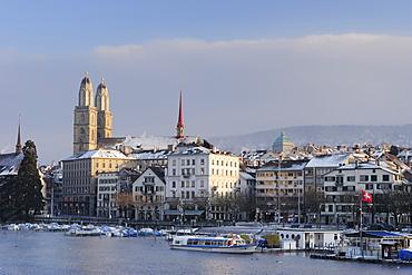 Church Grossmuenster with river Limmat in foreground, Zurich, Switzerland