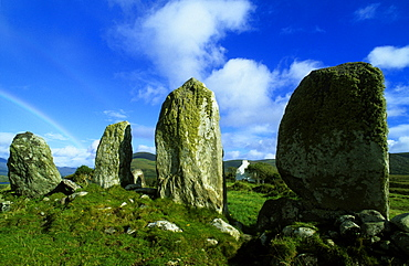 Menhirs under blue sky, County Kerry, Ireland, Europe