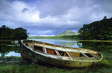 Small boat on shore of a lake at the Ring of Beara, County Kerry, Ireland, Europe