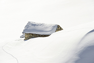 Snowy mountain hut, Tignes, Val d Isere, Savoie department, Rhone-Alpes, France