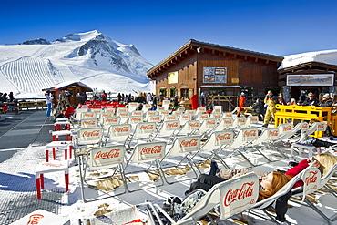 Deck chairs outside a mountain restaurant, Tignes, Val d Isere, Savoie department, Rhone-Alpes, France