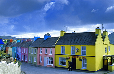 Colourful houses under grey clouds, Eyeries, Beara peninsula, County Cork, Ireland, Europe