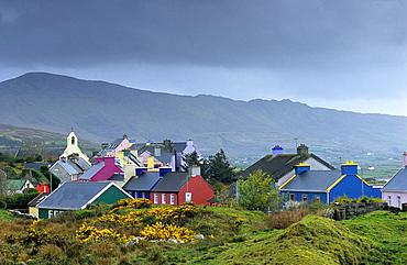Colourful houses under grey clouds, Eyeries, Beara peninsula, County Cork, Ireland, Europe