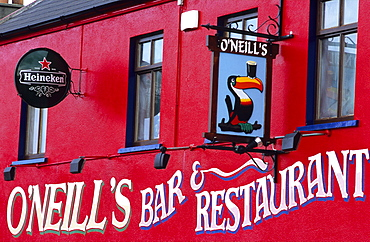 View at the bright red facade of O'Neill's Pub, Allihies, Ring of Beara, County Cork, Ireland, Europe