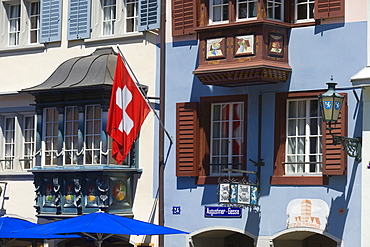 Windows of a house with the Swiss Flagger in the Augustinergasse, Zurich, Switzerland