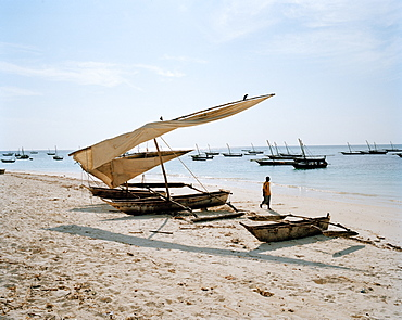 Traditional fishing canoe's laying on the beach of Nungwi, northern Zanzibar, Tanzania, East Africa