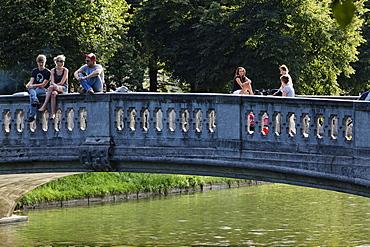 People on a bridge above the Nymphenburg canal, Gern, Munich, Upper Bavaria, Bavaria, Germany, Europe