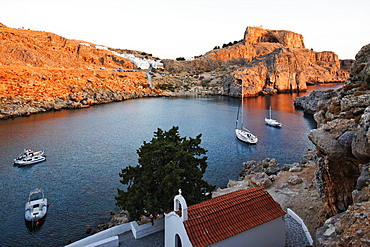 Agios Pavlos Bay and the ruins of the acropolis, Lindos, Rhodes, Dodecanese Islands, Greece, Europe