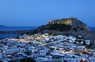 View over the roofs and onto the acropolis in the evening, Lindos, Rhodes, Dodecanese Islands, Greece, Europe