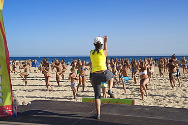 Gymnastics on the beach, Algarve, Portugal, Europe
