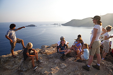 Tourists on the summit of Gemiler Island in Fethiye gulf, lycian coast, Mediterranean Sea, Turkey