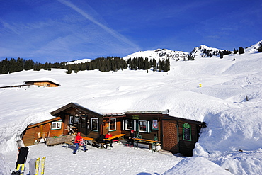 Snow covered alpine hut with Gebra in background, Hochwildalmhuette, Gebra, Kitzbuehel range, Tyrol, Austria, Europe