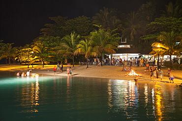Beach party with bonfire at night, Port Antonio, Portland, Jamaica, Caribbean