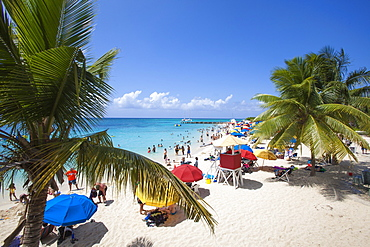 People relaxing and swimming at Doctor's Cave beach, Montego Bay, St. James, Jamaica, Caribbean
